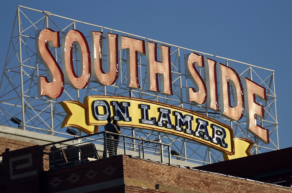 The view of the rooftop of NYLO Dallas South Side (foreground) during the Lamar Street Festival in Dallas, TX on October 19, 2013. The building is next door to the South Side on Lamar complex, whose sign is near the NYLO. (Kye R. Lee/The Dallas Morning News)